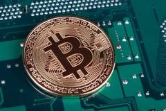 Bitcoin on circuit board. Bitcoin on printed circuit board royalty free stock image