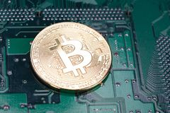 Bitcoin on circuit board. Bitcoin on printed circuit board royalty free stock images