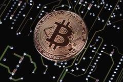 Bitcoin on circuit board. Bitcoin on printed circuit board royalty free stock photos