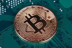 Bitcoin on circuit board. Bitcoin on printed circuit board stock photo