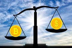 Bitcoin in priority against the background of the dollar on the scales. The concept of the prospects for crypto currency Stock Images