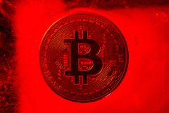 Bitcoin on the red ice royalty free stock images