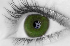 Bitcoin reflection of screen in  womans eye Stock Photography
