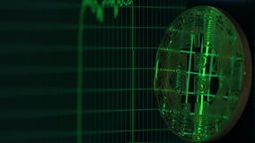 Bitcoin reflects rising and falling graph on the computer screen. Cryptocurrency raise and crisis related shot Royalty Free Stock Photos
