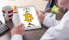 Bitcoin regulation concept on a tablet. Bitcoin regulation concept shown on a tablet held by a man royalty free stock image