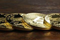 Bitcoin. In a row of 1 ounce American gold eagle bullion coins royalty free stock photos