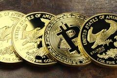 Bitcoin. In a row of 1 ounce American gold eagle bullion coins stock photo