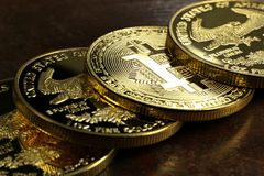 Bitcoin. In a row of 1 ounce American gold eagle bullion coins stock photography