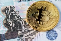 Bitcoin with Russian rubles. Bitcoins on Russian banknotes. stock images