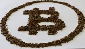 Bitcoin se hace a mano del plástico negro fotografía de archivo libre de regalías