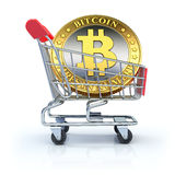 Bitcoin in the shopping cart Royalty Free Stock Photos