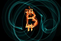 Bitcoin sign over black background Royalty Free Stock Images