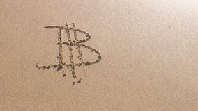 Bitcoin sign written in the sea sand. Waves washed away the inscription. Bitcoin sign written in the sea sand. Waves washed away the inscription stock footage