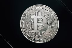 Bitcoin silver coin on black background. Virtual cryptocurrency concept. royalty free stock photo