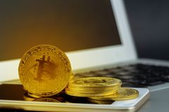 Bitcoin on smart mobile phone and laptop computer, gold coin wit. H currency digital exchange cash with crypto, technology about money, commercial and finance royalty free stock photo