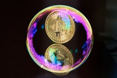 Bitcoin and a soap bubble on black background Stock Image