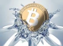 Bitcoin splashing into water. Royalty Free Stock Image