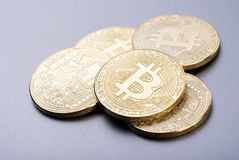 Bitcoin stack. A stack of physical bitcoins on neutral background Royalty Free Stock Images