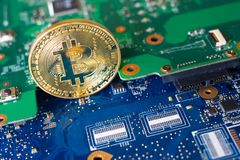 Bitcoin on motherboard Stock Photography