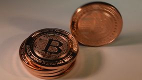 Bitcoin Copper Rounds Standing then Toppling Down, Finance Illustration stock video
