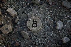 Bitcoin Symbol on Dirt or Debris stock photography