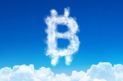 Bitcoin symbol in the form of clouds of steam against a blue sky. Bitcoin symbol in the form of clouds of steam against a blue sky Royalty Free Stock Photo