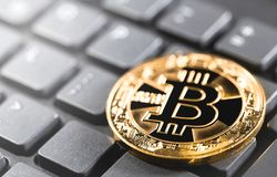 Bitcoin on the keyboard Royalty Free Stock Images