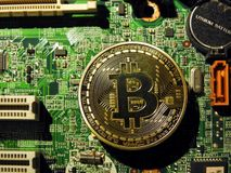 Bitcoin symbol on motherboard. A close up of bitcoin symbol on the motherboard Royalty Free Stock Photography