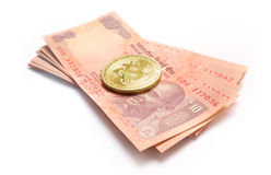 Bitcoin taking over Indian Currency Royalty Free Stock Images