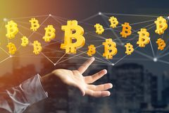 Bitcoin teckenflyg runt om en nätverksanslutning - 3d framför Royaltyfri Bild