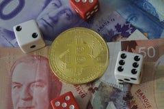 Bitcoin token with money and dice. A bitcoin token with money and dice Royalty Free Stock Image