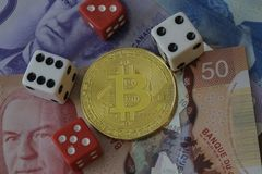 Bitcoin Token with Money and Dice Royalty Free Stock Image