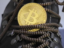 Bitcoin on top of boot. Royalty Free Stock Photography