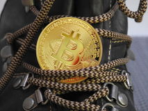 Bitcoin on top of boot. Stock Photo