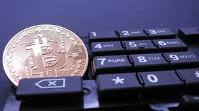 Bitcoin on top of computer number keyboard part Royalty Free Stock Photography