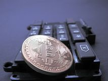 Bitcoin on top of computer part Royalty Free Stock Photo
