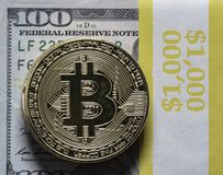 Bitcoin closeup with US currency Royalty Free Stock Photos