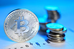 Bitcoin trading concept. Silver Bitcoin coin on the candle stick graph. Trading concept Royalty Free Stock Images