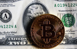 Bitcoin on two dollar bill. Bitcoin on two dollar banknote. Trading concept Stock Images