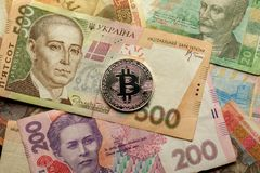 Bitcoin and Ukraine national currency - hryvnya Royalty Free Stock Photos