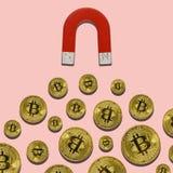 Bitcoin und Magnet ziehen an stockbilder
