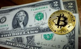 Bitcoin with US Dollar bank note Stock Image