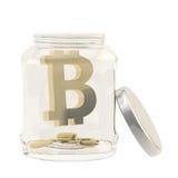 Bitcoin valuta undertecknar in en glass krus Arkivfoton