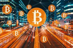 Bitcoin with motion blurred traffic. Bitcoin with view of motion blurred traffic Stock Image