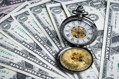Bitcoin and vintage pocket watch on money dollar banknotes using. As time for crypto currency concept, Bitcoin is the main and most famous of digital currency Stock Photography
