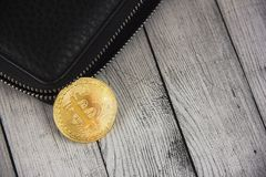 Bitcoin in the wallet. Business concept.Bitcoin falls out of the royalty free stock photo