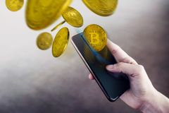 Bitcoin Wallet on Smartphone Concept, Woman using Mobile Phone t. O Earn or Pay via Cryptocurrency Market. Flying Golden Coin royalty free stock images