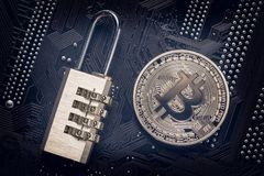 Free Bitcoin With Padlock On Computer Motherboard. Crypto Currency Internet Data Privacy Information Security Concept. Stock Image - 118137001