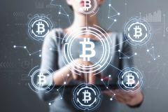 Bitcoin with woman using a tablet royalty free stock photography