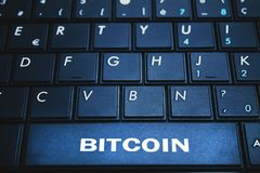 Bitcoin word on the computer keyboard. Blockchain concept. Stock Photography